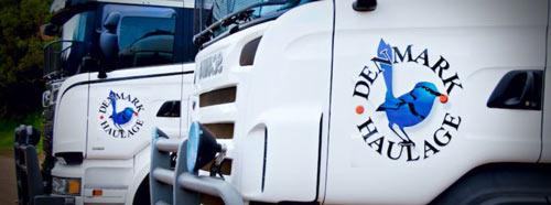Clos up photo of 2 Denmark Haulage SCANIA trucks